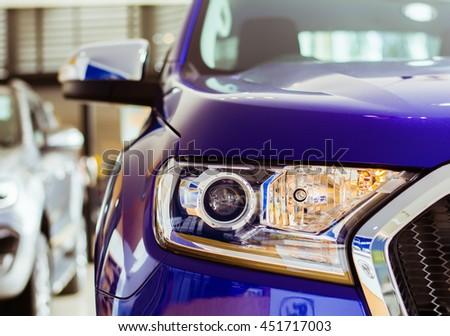 Bangkok,Thailand, Selective focus headlight of new car in event car JULY 12 2016 BANGKOK,THAILAND. - stock photo