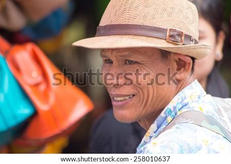 bangkok, Thailand-Sep 17th 2012: Portrait of a street vendor. Street vendors can be found all over the city. - stock photo