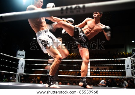 BANGKOK, THAILAND-SEPT 25: Unidentified fighter in Muaythai.During the Thai Fight Muay Thai ...The World's Unrivalled Fight at Thammasat University stadium on September 25,2011 in Bangkok,Thailand - stock photo