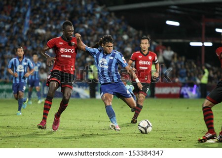 BANGKOK,THAILAND-SEPTEMBER 7:Dagno(No.21) player of SCG Muangtong United in action during The TPL 2013 between MTUTD and Chonburi FC at SCG Mungthong Stadium on Sep 7, 2013 in,Thailand. - stock photo
