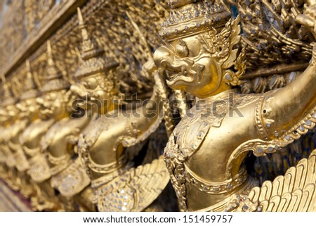 BANGKOK, THAILAND - SEPTEMBER 20 : Golden garuda statues at Wat Phra Kaew in Grand Palace on september 20 , 2012 in Bangkok, Thailand.  - stock photo