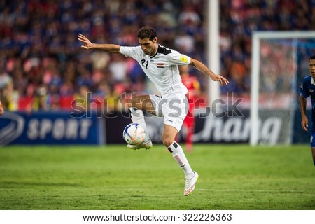 BANGKOK,THAILAND SEPTEMBER 08:Saad Abdul-Amir no.21 of Iraq for the ball during the 2018 FIFA World Cup Qualifier between Thailand and Iraq at Rajamangala Stadium on Sep 8, 2015 in Thailand. - stock photo