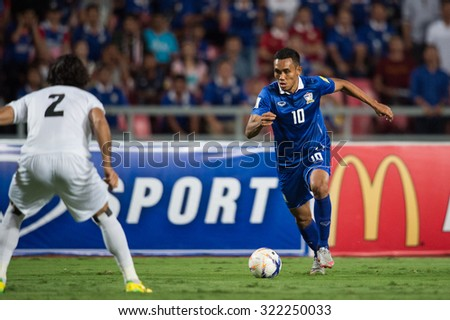 BANGKOK,THAILAND SEPTEMBER 08:Teerasil Dangda (blue) of Thailand in action during during the 2018 FIFA World Cup Qualifier between Thailand and Iraq at Rajamangala Stadium on Sep 8, 2015 in Thailand. - stock photo