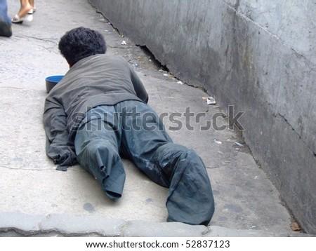 BANGKOK, THAILAND- SEPTEMBER 2: Thai crippled man on the streets begging September 2, 2007 in Bangkok. - stock photo