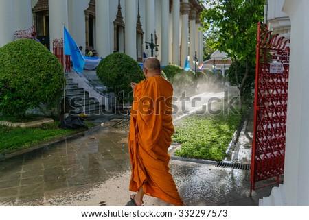 Bangkok, Thailand - September 5, 2015 : Thai monk walking in temple to worship in Wat Thep Sirin Thrawat Ratchaworawihan. - stock photo