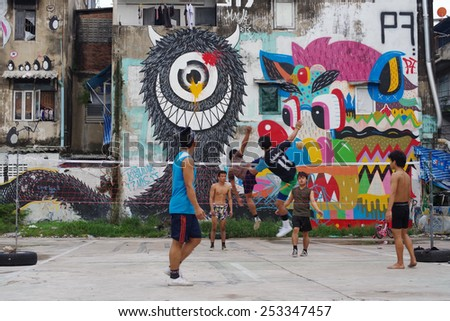 BANGKOK, THAILAND - SEPTEMBER 21 : Unidentified men play Sepaktakraw with street art wall background on September 21, 2013 in Bangkok, Thailand - stock photo