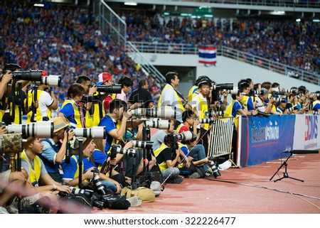 BANGKOK,THAILAND SEPTEMBER 08:Unidentified Thai photographer in action during the 2018 FIFA World Cup Qualifier between Thailand and Iraq at Rajamangala Stadium on Sep 8, 2015 in Thailand. - stock photo
