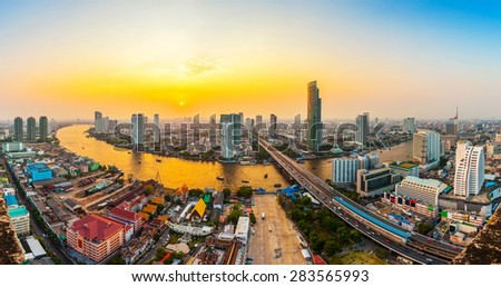 Bangkok Transportation at Dusk with Modern Business Building along the Chaopraya river (Thailand) - stock photo
