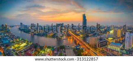 Bangkok Transportation at Dusk with Modern Business Building along the river (Thailand) - stock photo