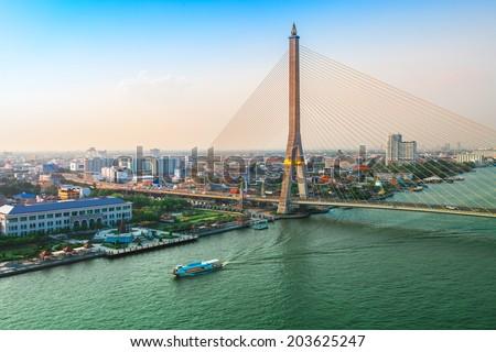 Bangkok Transportation at Dusk with the bridge across the river (Thailand) - stock photo