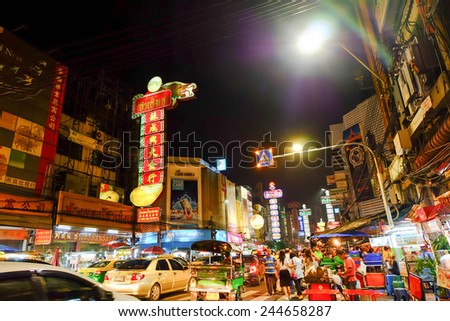 BANGKOK -: Yaowarat Road in the evening on JULY 06, 2014 in Bangkok. Yaowarat Road is a main street in Bangkok's Chinatown, it was opened in 1891 in the reign of King Rama V. - stock photo