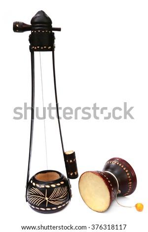 Bangladeshi musical instrument Ektara and Dugdugi over white background - stock photo
