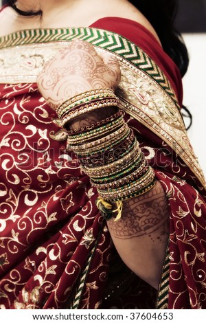 Bangles on the arm of a young hindu bride - stock photo