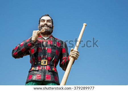 BANGOR, MAINE , USA - AUGUST 27 2014: Statue of the legendary character Paul Bunyan, a mythical giant lumberjack. In Bangor, USA 27th August 2014. - stock photo