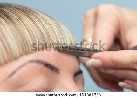 bangs haircut at the beauty salon - stock photo