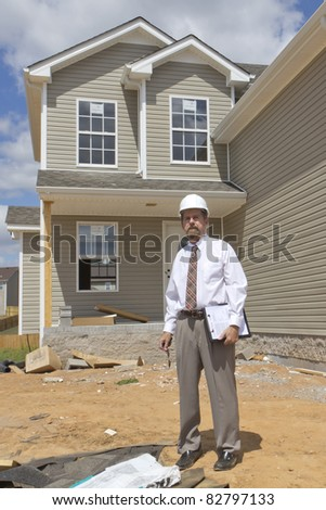 Bank finance personal inspecting new home, his company financed the builder - stock photo