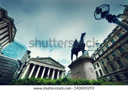 Bank of England, the Royal Exchange and the Wellington statue in London, the UK - stock photo
