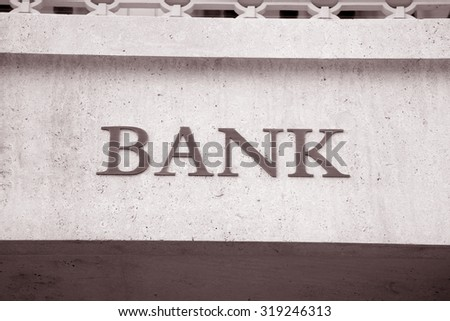 Bank Sign in Urban Setting in Black and White Sepia Tone - stock photo