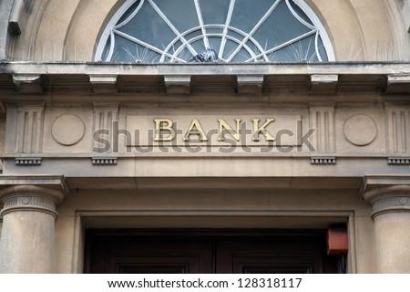 Bank Sign over Entrance Door - stock photo