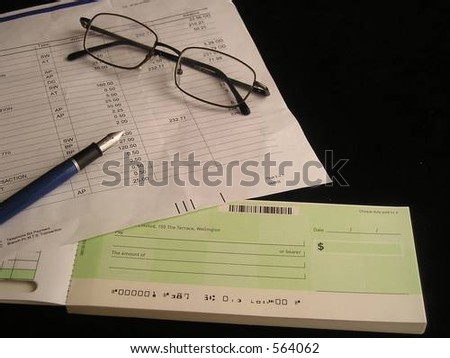 bank statement and chequebook - stock photo