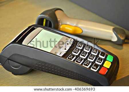 Bank terminal with hand reader of barcode - stock photo