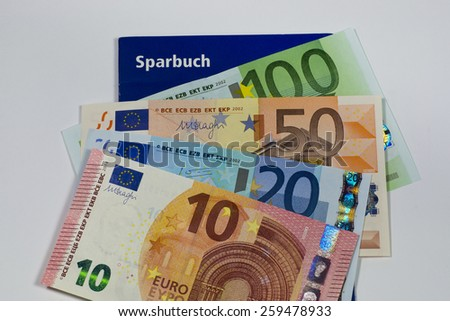 Bankbook and Euro notes - stock photo