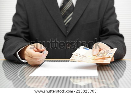 Banker offering money if you sign contract - stock photo