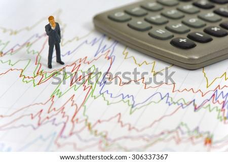 banker standing on chart of stock exchange - stock photo