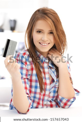 banking and shopping concept - happy teenage girl with credit card - stock photo