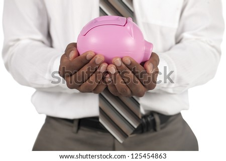 Banking concept represented by businessman holding a piggy bank - stock photo