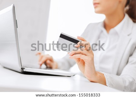 banking, shopping, money concept - businesswoman with laptop and credit card - stock photo