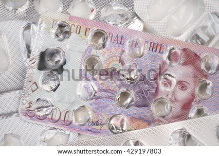 Banknote 2000 Chilean Peso on an empty blister pack of tablets - stock photo