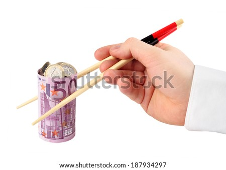 Banknote. Hand takes banknote in the form of sushi stuffed with coins on white background - stock photo