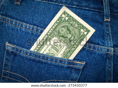 Banknote of one american dollar in the back jeans pocket - stock photo