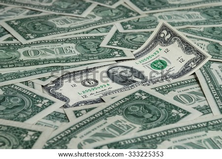 Banknote par value of two dollars located among many dollar bills - stock photo