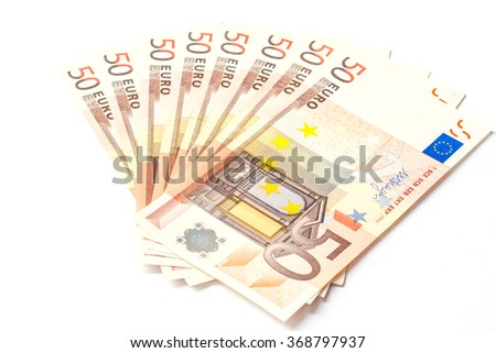 banknotes and coins money useful as a background or money concept - stock photo