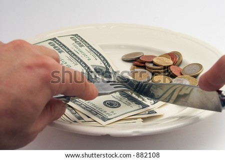 banknotes and coins on a plate as a meal - stock photo