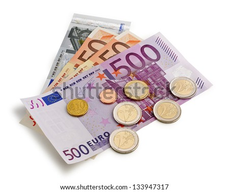 banknotes and coins on white background - stock photo