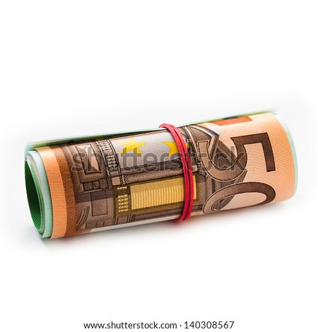 banknotes, euro banknotes rolled into a tube and tied with a rubber band - stock photo