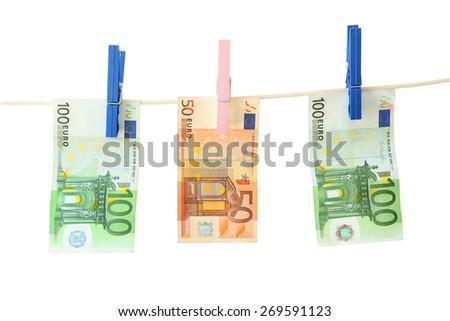 Banknotes euro on clothesline. White background  - stock photo