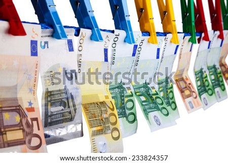 Banknotes hanging on a clothesline - stock photo