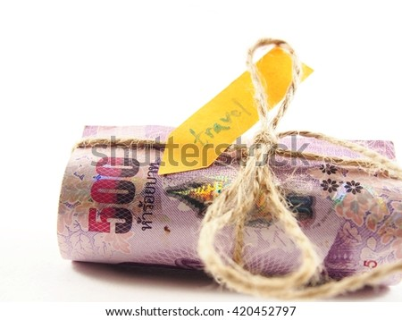 Banknotes money rope ribbon by brown string, isolated on white background, travel plan money concept
