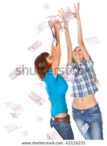 Banknotes of 500 euro are falling on two girls. Isolated on white background - stock photo