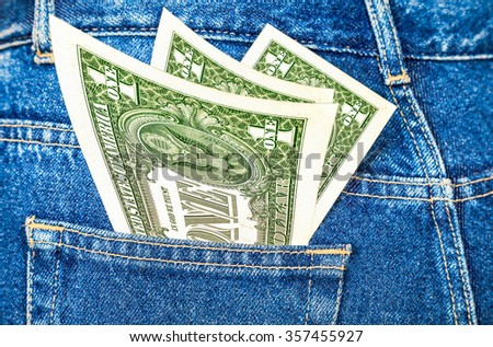 Banknotes of one american dollar sticking out of the back jeans pocket - stock photo