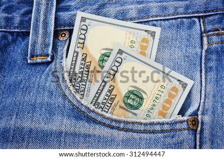 Banknotes of one hundred american dollars in the jeans pocket - stock photo