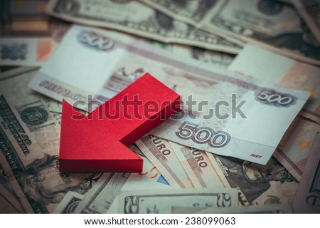 Banknotes of russian roubles on us dollars and european euros. Devaluation of the Russian rouble.  Toned picture - stock photo