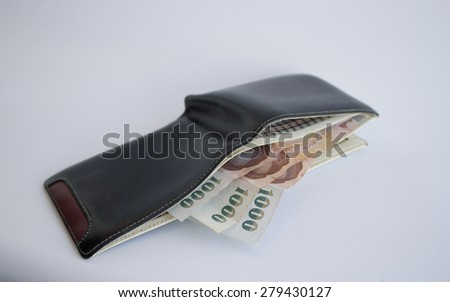 Banknotes of Thailand in wallet on white background - stock photo
