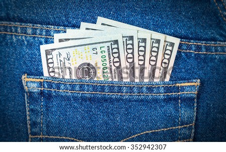 Banknotes of U. S.  dollars in the back jeans pocket - stock photo