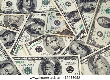 Banknotes of United States of America - dollars - ona one heap. There are all included - 100, 50, 20, 10, 2 and a 1 dollar bills in this money background - stock photo