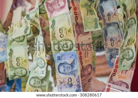 Banknotes thai donated in temple - stock photo